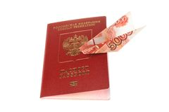 Russian international passport with origami plane made from bank Stock Photography