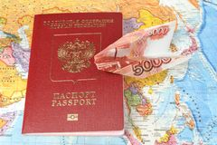 Russian international passport with origami plane made from mone Royalty Free Stock Image