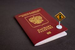 Russian international passport with a yellow arrow road sign - migration concept royalty free stock photos