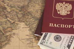 Russian International passports with dollars on  world map Royalty Free Stock Photo
