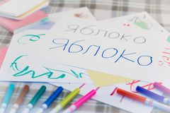 Russian; Kids Writing Name of the Fruits for Practice Stock Photo