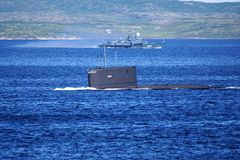 A Russian Kilo Class diesel-electric submarine is diving in Kola Bay, Russia. A Russian Kilo Class diesel-electric submarine is diving in Kola Bay, Russia, on a stock photo
