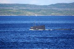 A Russian Kilo Class diesel-electric submarine is diving in Kola Bay, Russia. royalty free stock images