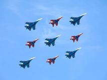 Russian Knights and Swifts in flight against blue sky Royalty Free Stock Image