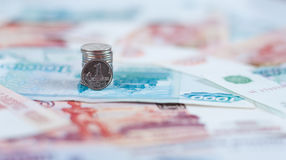 Russian Kopeck on background of  banknotes Stock Photography