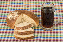 Russian kvas in mug and slices of bread on tablecloth Stock Image
