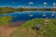 Russian Lake Landscape with Wooden Chair Stock Photo