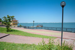 Russian lake with restaurant and boat. Russian terrace near a lake in Chelyabinsk with steel fence stock photos