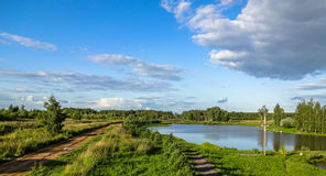 Russian landscape at the pond in the summer. Royalty Free Stock Images