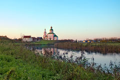 Russian landscape with river Kamenka and Church Stock Photos