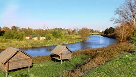 Russian landscape with river Kamenka, lodges for birds and Churc Stock Images