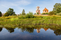 Russian landscape with tranquil river and old church in th Stock Photography