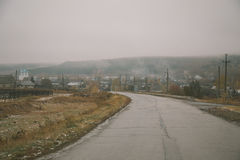 Russian little village countryside at misty fog Royalty Free Stock Image