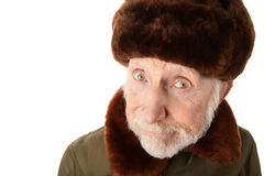 Russian Man in Fur Cap. Senior Russian Man in Fur Cap and jacket Royalty Free Stock Photography