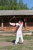 Russian man in national dress archery Royalty Free Stock Photos