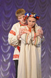 Russian man and woman in national costume Stock Images