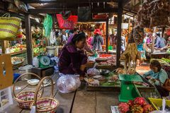 Russian market in Phom Penh, Cambodia. PHNOM PENH, CAMBODIA - AUGUST 11, 2015: A market vendor waits for customers in the Russian market in Phnom Penh Stock Photography