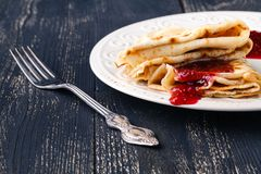 Russian Maslenitsa, Shrovetide, pancake week, carnival, shrove,. Pancake day. a stack of pancakes with butter upstairs on plate, on wooden background, close-up stock photo