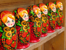 Russian Matryoshka Dolls. A line of Matryoshka dolls on display in a Russian market Royalty Free Stock Photo