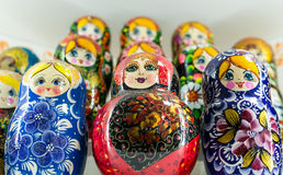 Russian Matryoshka Nesting Dolls. Close-up image of many Russian Matryoshka nesting dolls. The famous Russian souvenir uses bright vibrant hand painted paints on Royalty Free Stock Image