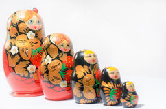 Russian matryoshkas on a light background and a colored background. Royalty Free Stock Photography