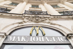 Russian McDonalds. Mc Donalds sign in russian with copy space Royalty Free Stock Photo