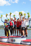 Russian men team rowing with medals on pedestal Stock Images