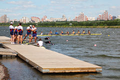Russian men team rowing at pier Stock Image