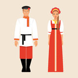 Russian men and women in national costumes Stock Image