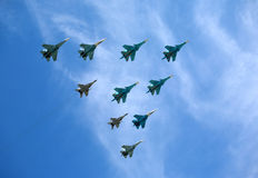 Russian military aircraft fighters in flight against blue sky Stock Photo