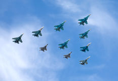 Russian military aircraft fighters in flight against blue sky Stock Photography
