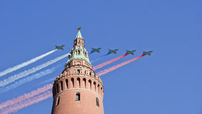 Russian military aircrafts fly in formation over Moscow during Victory Day parade, Russia. Russian military aircrafts fly in formation over Moscow Kremlin Royalty Free Stock Photography