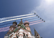 Russian military aircrafts fly in formation over MoscowSaint Basil cathedral during Victory Day parade, Russia Stock Image