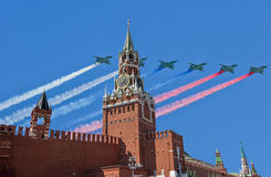 Russian military aircrafts fly in formation over MoscowSpassky Tower of Moscow Kremlin during Victory Day parade, Russia.  Royalty Free Stock Photography