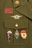 Russian military badges. On a green uniform Stock Images
