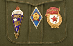 Russian military badges. On a green uniform Royalty Free Stock Photography