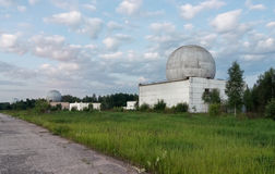 Russian military base in the forest with several big domes of a radar antenna Royalty Free Stock Photos