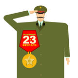 Russian military with big medal. Officer in uniform. Patriot Nat. Ional Military holiday. Russian text: 23 February. Defenders of Fatherland Day in Russia Royalty Free Stock Photography