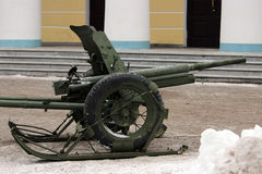 Russian military green gun on runners that facilitate transportation. Royalty Free Stock Photos