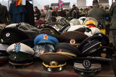 Russian military hats at Militalia 2013 in Milan, Italy Stock Photography