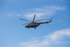 Russian military helicopter MI-8 in the blue sky Stock Photo
