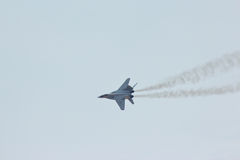 Russian military jet fighter MIG-29 make virage Stock Photos