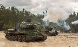 Russian military tank T34 on battlefield Stock Photos