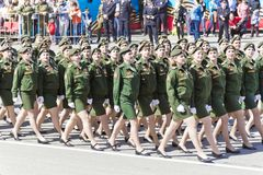 Russian military women are marching at the parade on annual Vict. SAMARA, RUSSIA - MAY 9: Russian military women are marching at the parade on annual Victory Day Royalty Free Stock Images