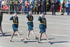 Russian military women are marching at the parade on annual Vict. SAMARA, RUSSIA - MAY 9: Russian military women are marching at the parade on annual Victory Day Stock Photo