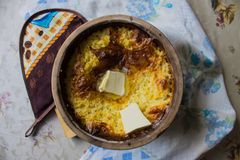 Russian millet porridge with butter in a ceramic dish out of the oven royalty free stock photos