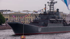 Russian Missile Ship. Russian large landing ship. A warship moored in the city center. On masts waving flags holidays stock video footage