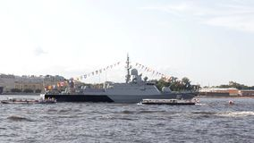 Russian modern military warship at the parade in Saint Petersburg in the Neva River and tourist boats stock video