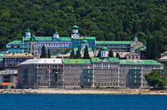Russian monastery on a coast of aegean sea below the holy mountain Athos Stock Images