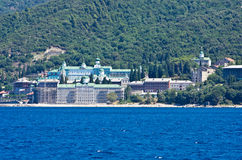 Russian monastery on a coast below the holy mountain Athos Royalty Free Stock Images